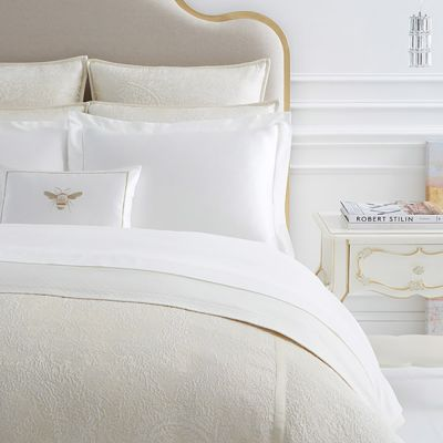 Seta Solid Duvet Cover is layered with the Dorato Jacquard Duvet Cover