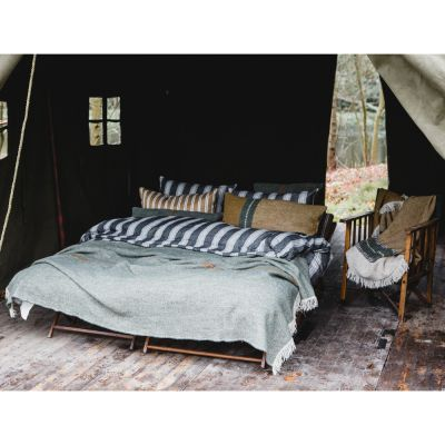 Montana Bed: Duvet & Shams are Tahoe Stripe in Charcoal; Bronze colored sham (middle left) is Canal Stripe in Gold; Throw at foot of bed is Idaho Olive; Lumbar pillow (front right) is Montana Gold; Throw on the chair is Montana Gold.